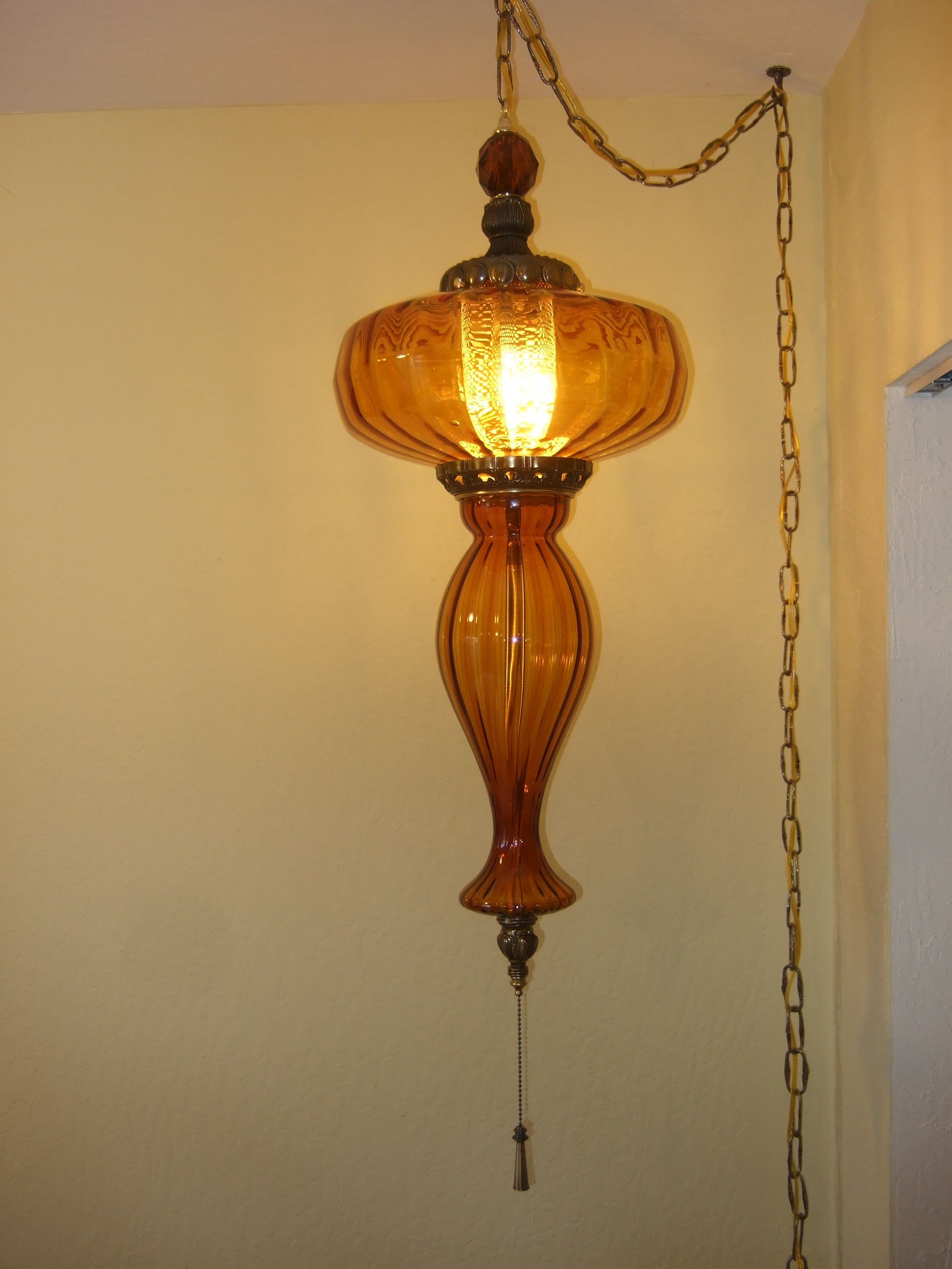 This is an amber swag lamp i designed from repurposing parts from