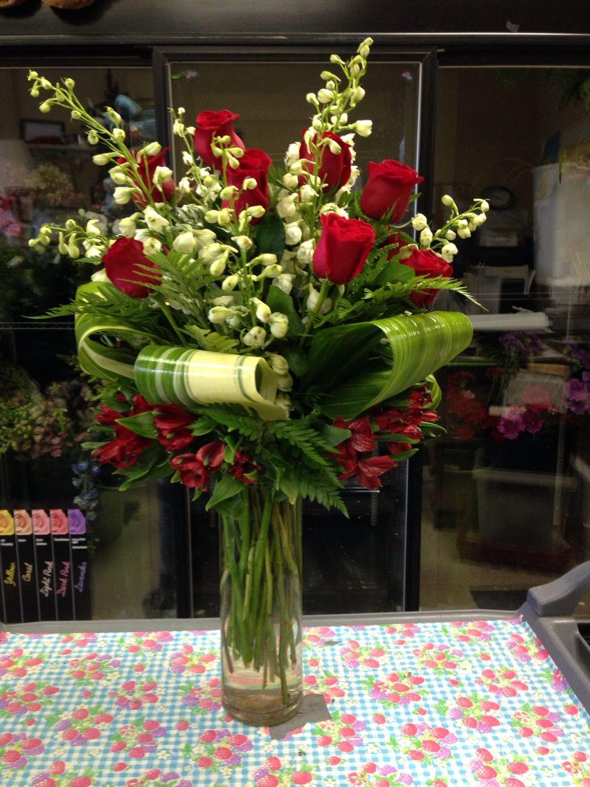 Flowers i designed in a tall cylinder vase using white delphinium flowers i designed in a tall cylinder vase using white delphinium roses aspidistra leaves reviewsmspy