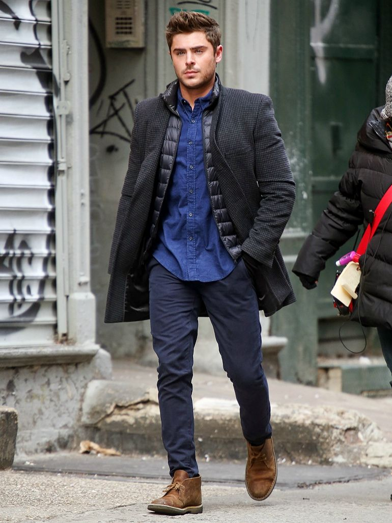 mens street style zac efron black coat blue shirt blue chinos brown desert  boots 20ac7a5ea