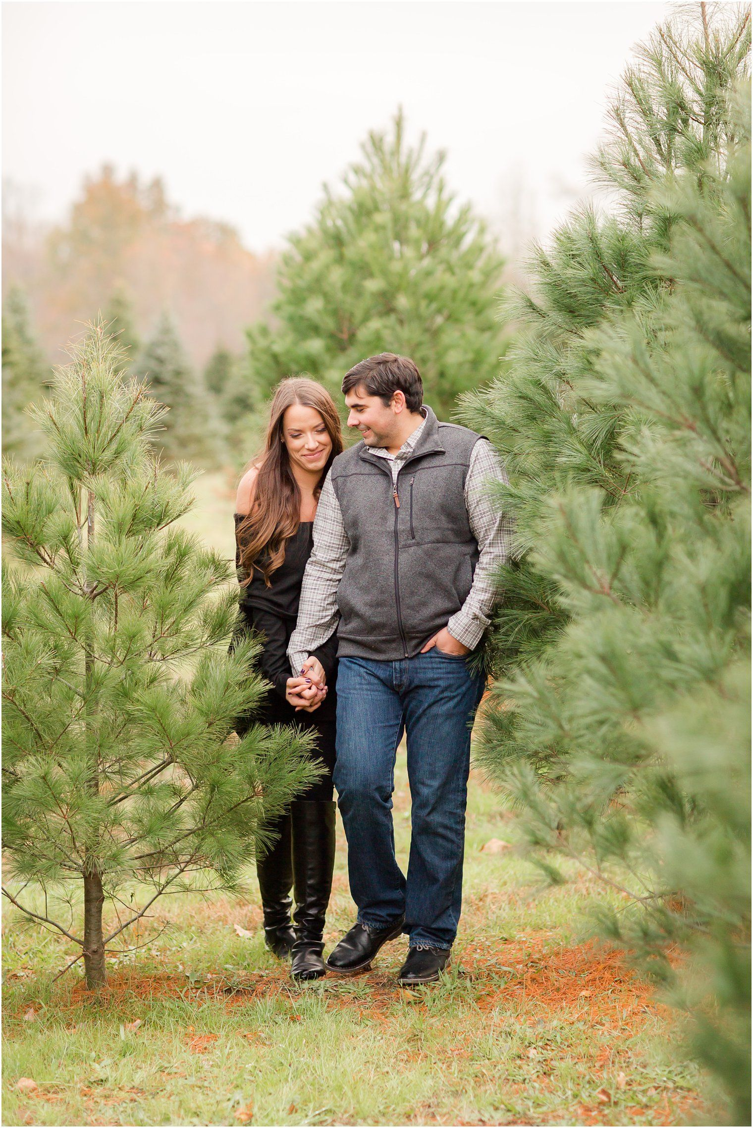 Engaged couple walking on a Christmas tree farm by NJ Engagement ...