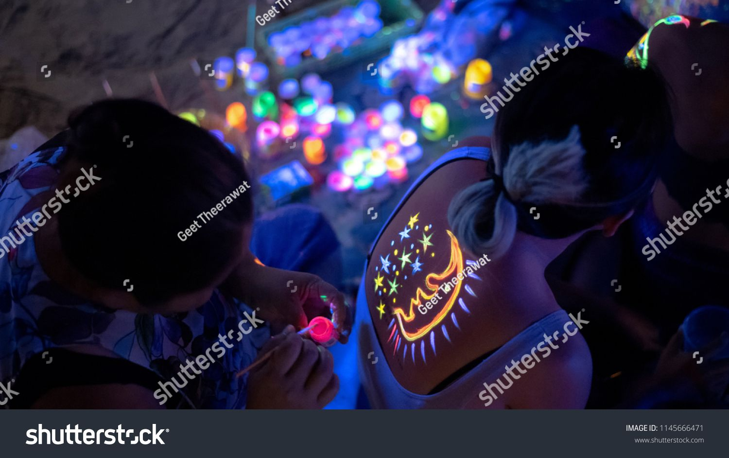 a434999256 Tourists with neon makeup, which made of fluorescent paint in ultraviolet  light at Full Moon Party Rin Beach, Koh Phangan, Thailand ;Full Moon ...