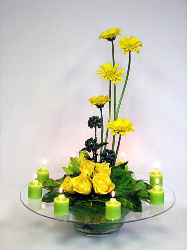 Yellow and lime green design - a collar of XFatshedera lizei variegata leaves, 5 yellow Gerberas, 5 yellow Roses, some yellow lily buds  with some Hedera helix berries ~Chrissie Harten