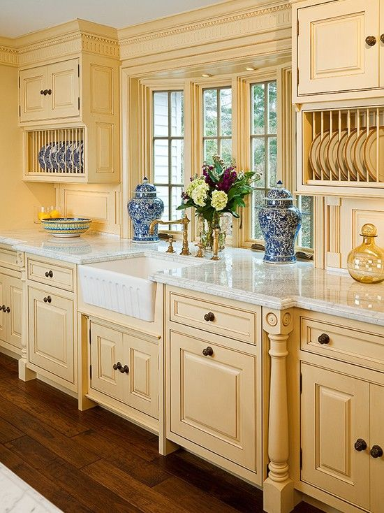 French Country Kitchen In Yellow With Blue Accents