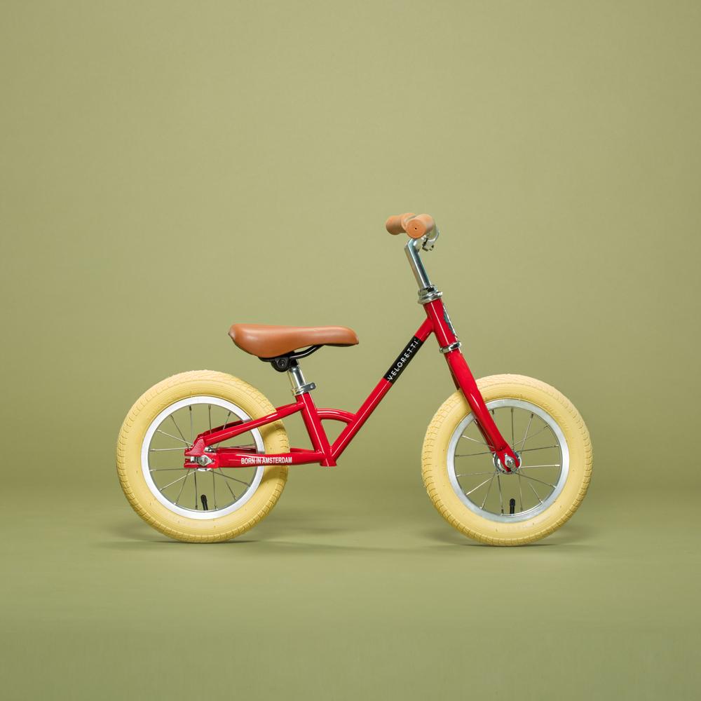 The Veloretti Mini – Dakota Red, a stylish balance bike inspired ...