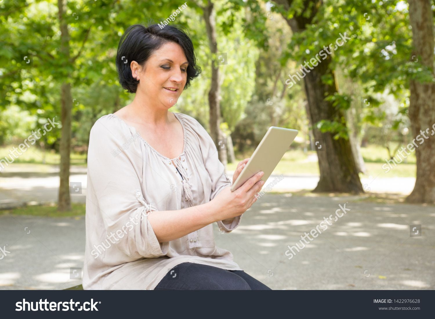 Happy Peaceful Woman Consulting Internet On Tablet Outdoors Middle Aged Caucasian Lady Sitting On Park Bench Usin Motion Graphics Animation Outdoor Caucasian