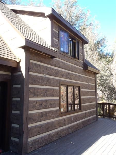 Everlog 16 hand hewn concrete log siding apparently for Hewn log cabin kits