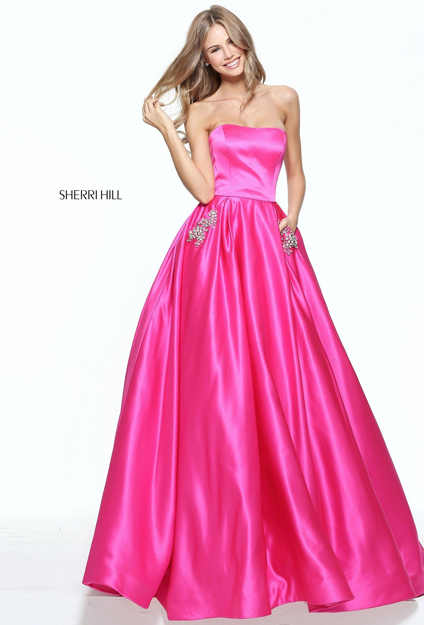 eb583d68919 There s no fairy godmother required for Sherri Hill 50812. Feel like a true  princess in this strapless satin ball gown. The fitted bodice adds a  beautiful ...