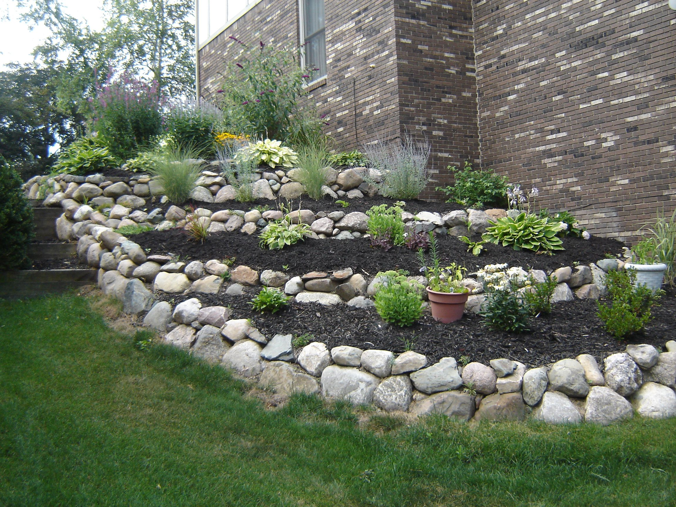 4 Tier Boulder Wall Rock Garden Landscaping Backyard Landscaping Designs Rock Wall Gardens