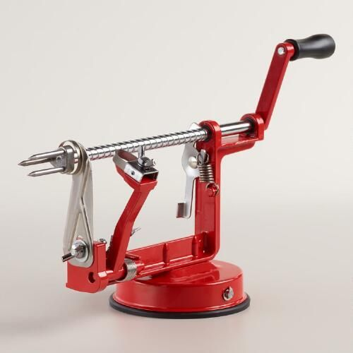 One of my favorite discoveries at WorldMarket.com: Red Enameled Cast Iron Apple Peeler, Slicer and Corer