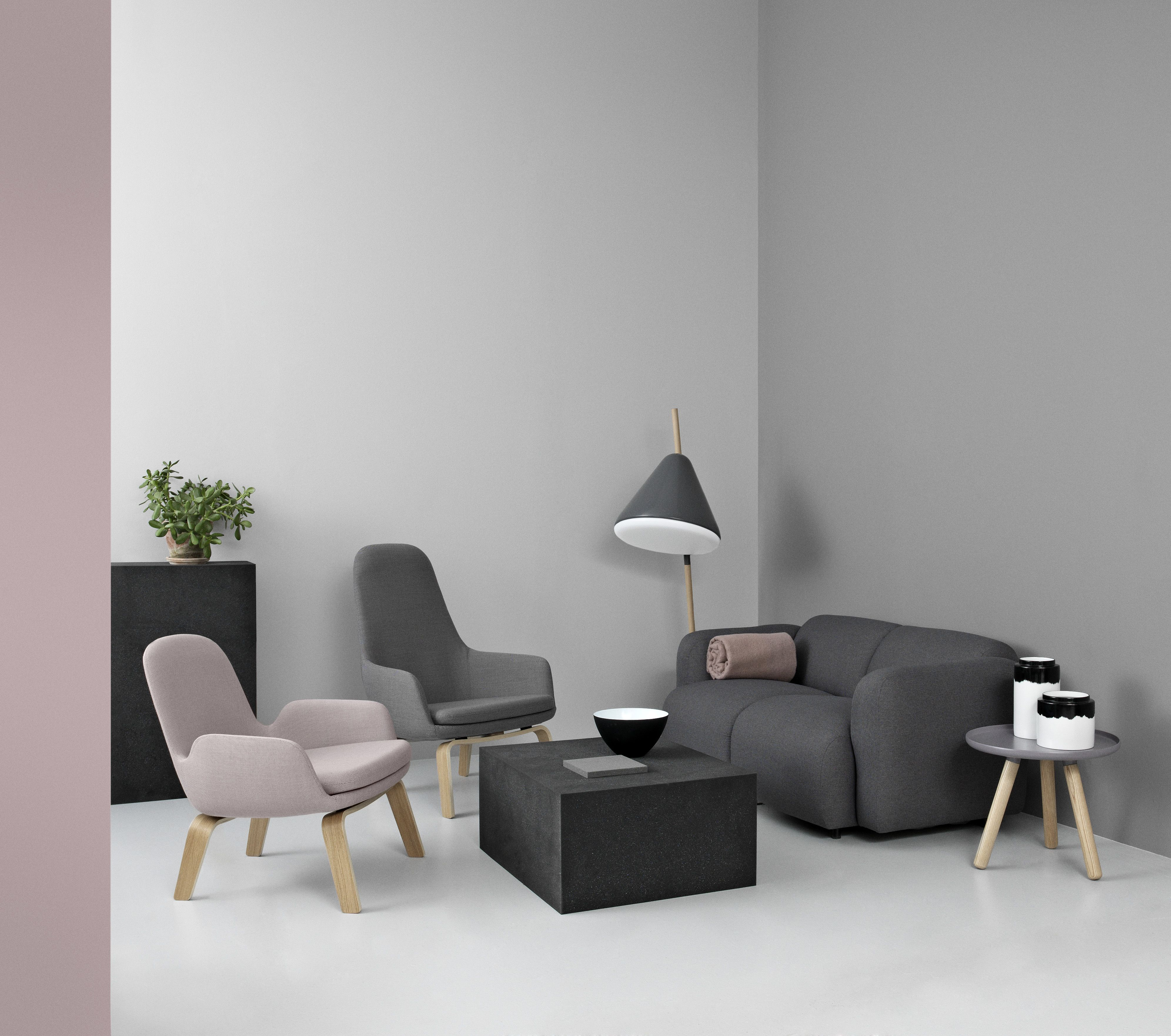 Swell sofa ac panied by Era lounge chairs in dusted tones