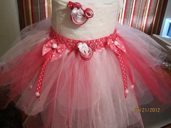 Beautiful Minne Mouse tutu & matching hair clip. Size 6-24mos. Made to order. Available for purchase at www.facebook.com/gracelikerainbowtique or www.etsy.com/shop/tmjoy728.