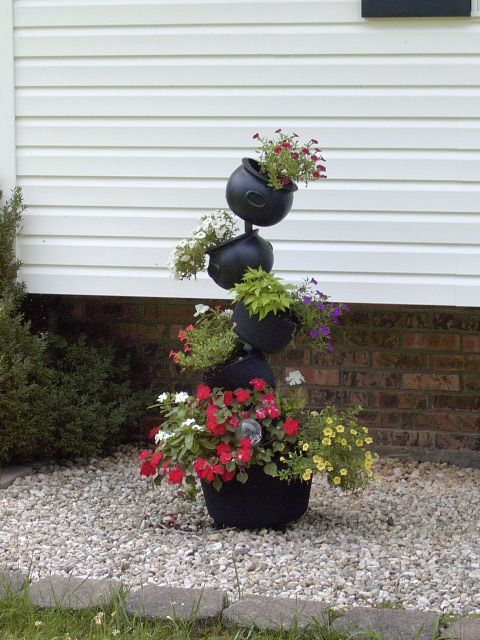 45 Cool Tipsy Pot Planters   Style Estate