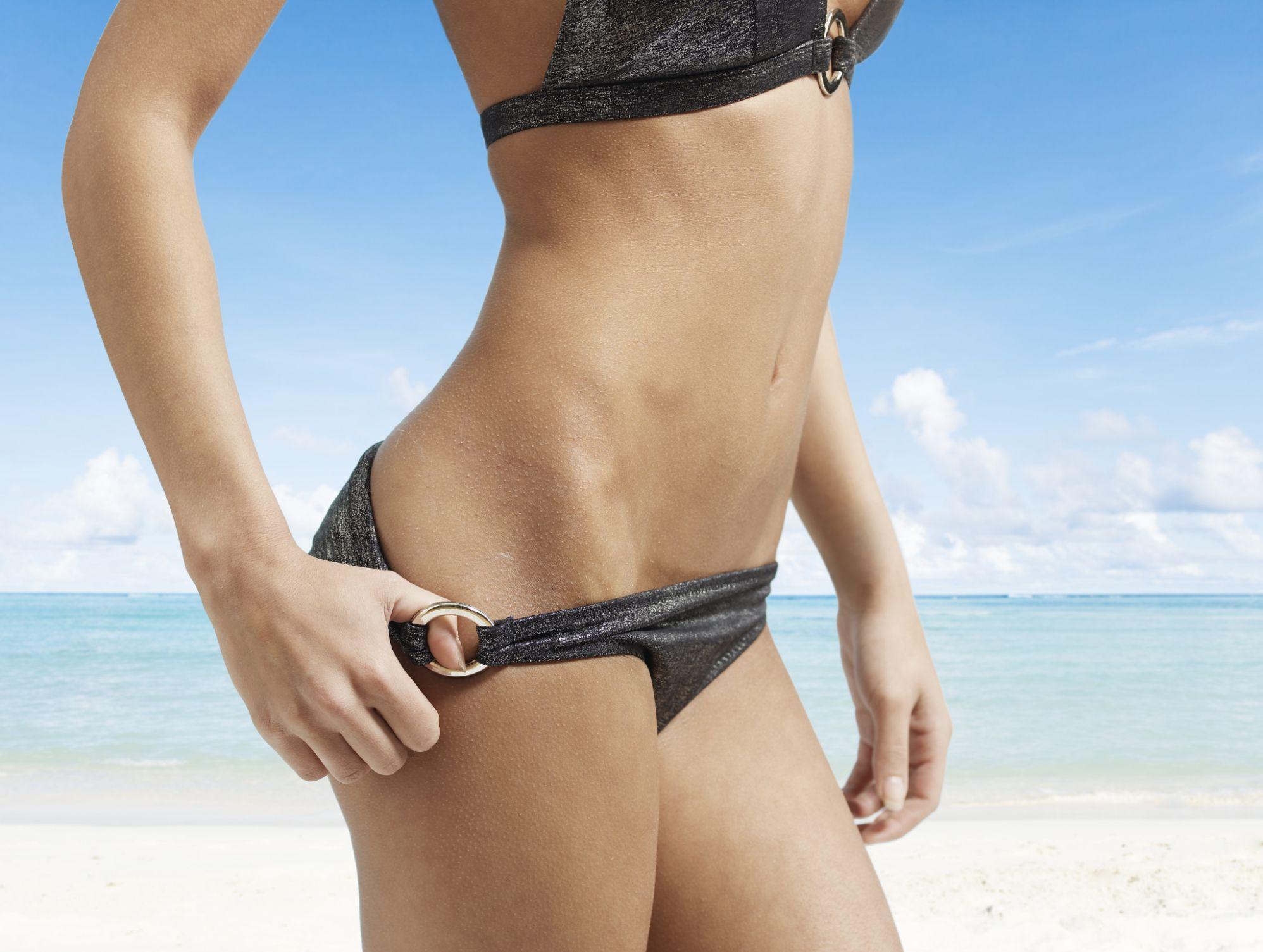 Midsection View of Woman Pulling Bikini Bottom ingrownhairremedies