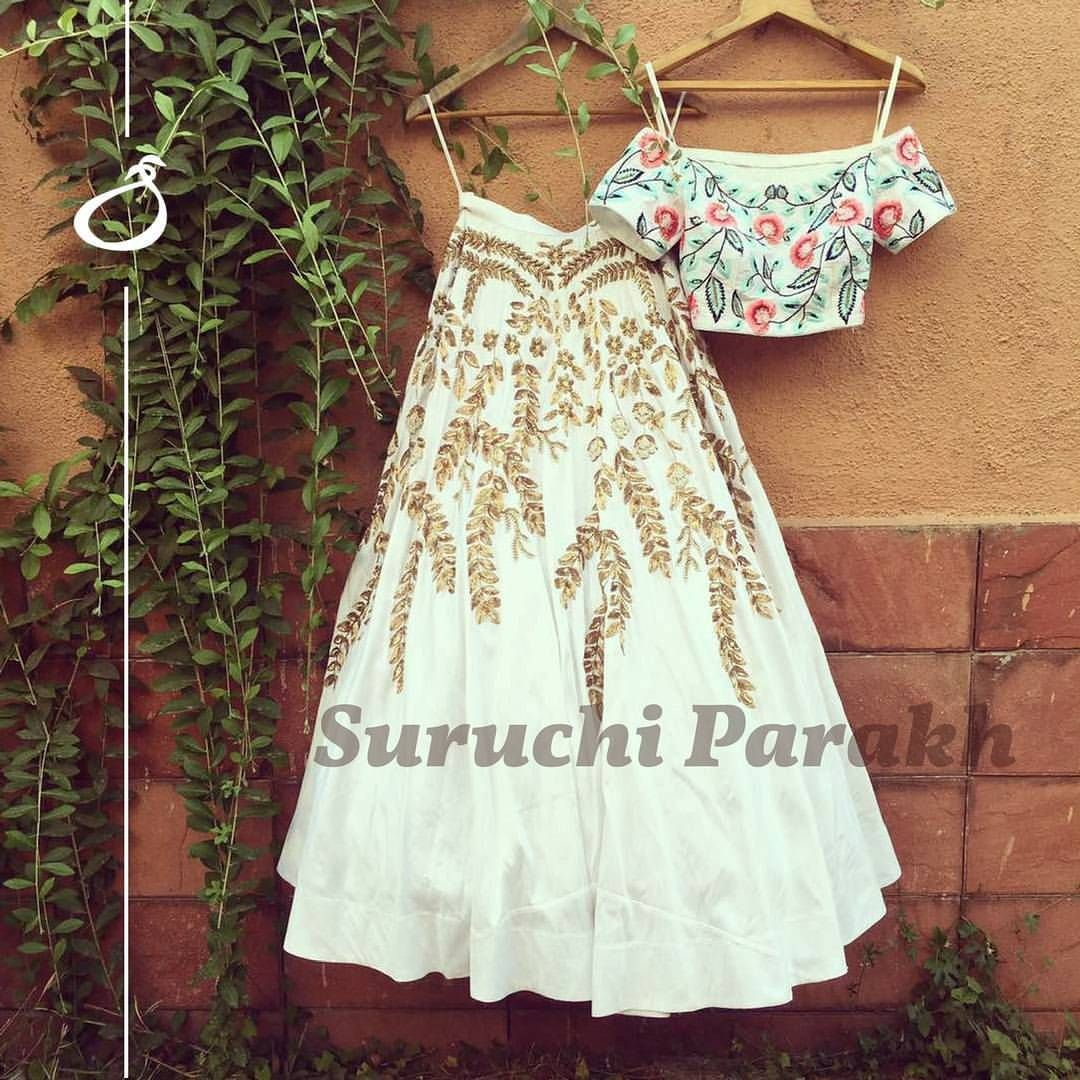 We are in love with this beauty Suruchi designed. Gorgeous skirt with handwork wines falling down so gracefully from the waist paired with the most beautiful off shoulder crop top embroidered with soft pastel hues and embellished with gold. 