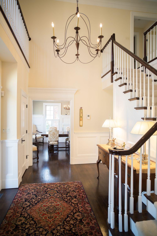 elegant entryway with lofted ceilings open stairway dark on floor and decor id=26204