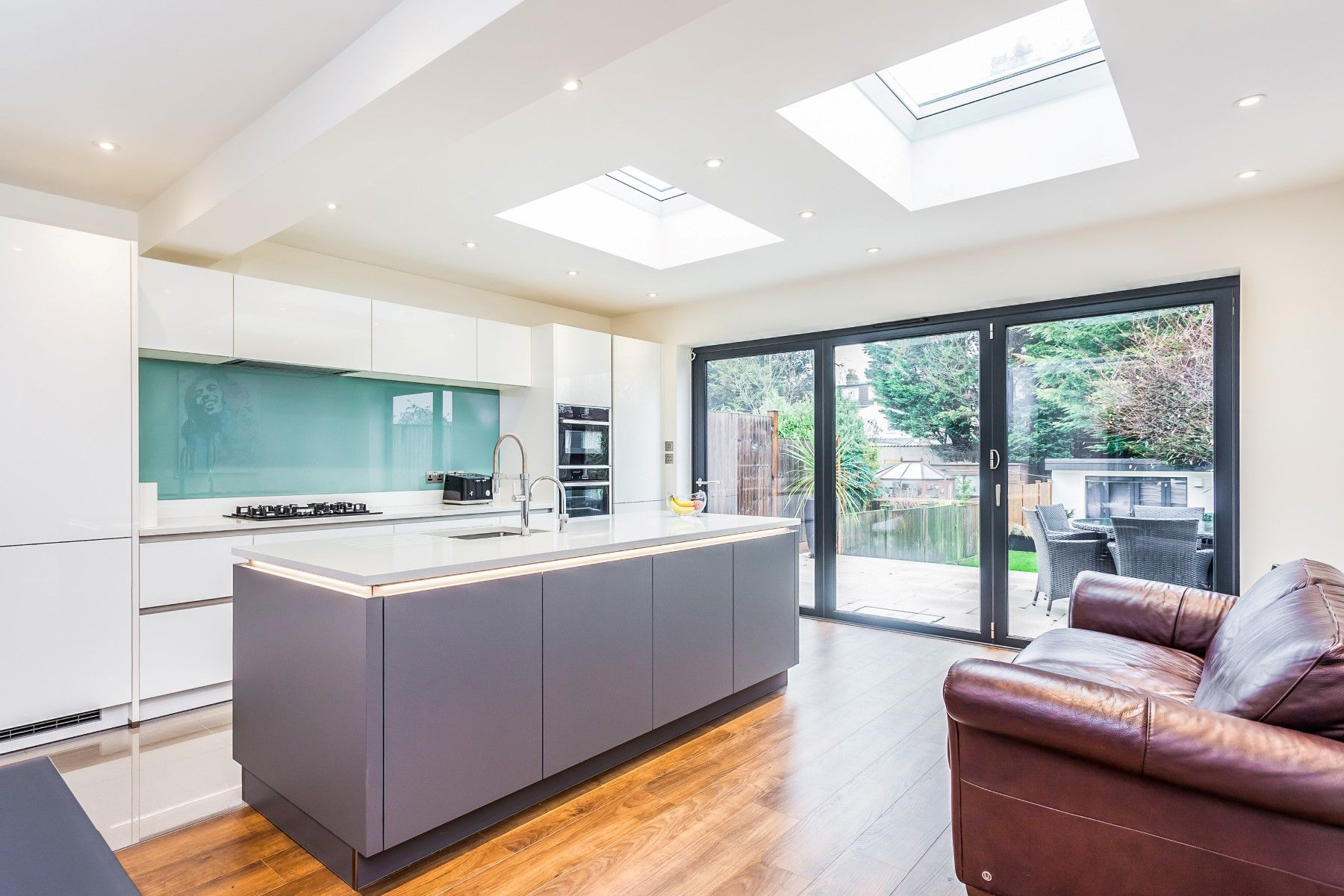Our beautiful Nolte Handleless Kitchen in Feel White and Quartz Grey ...