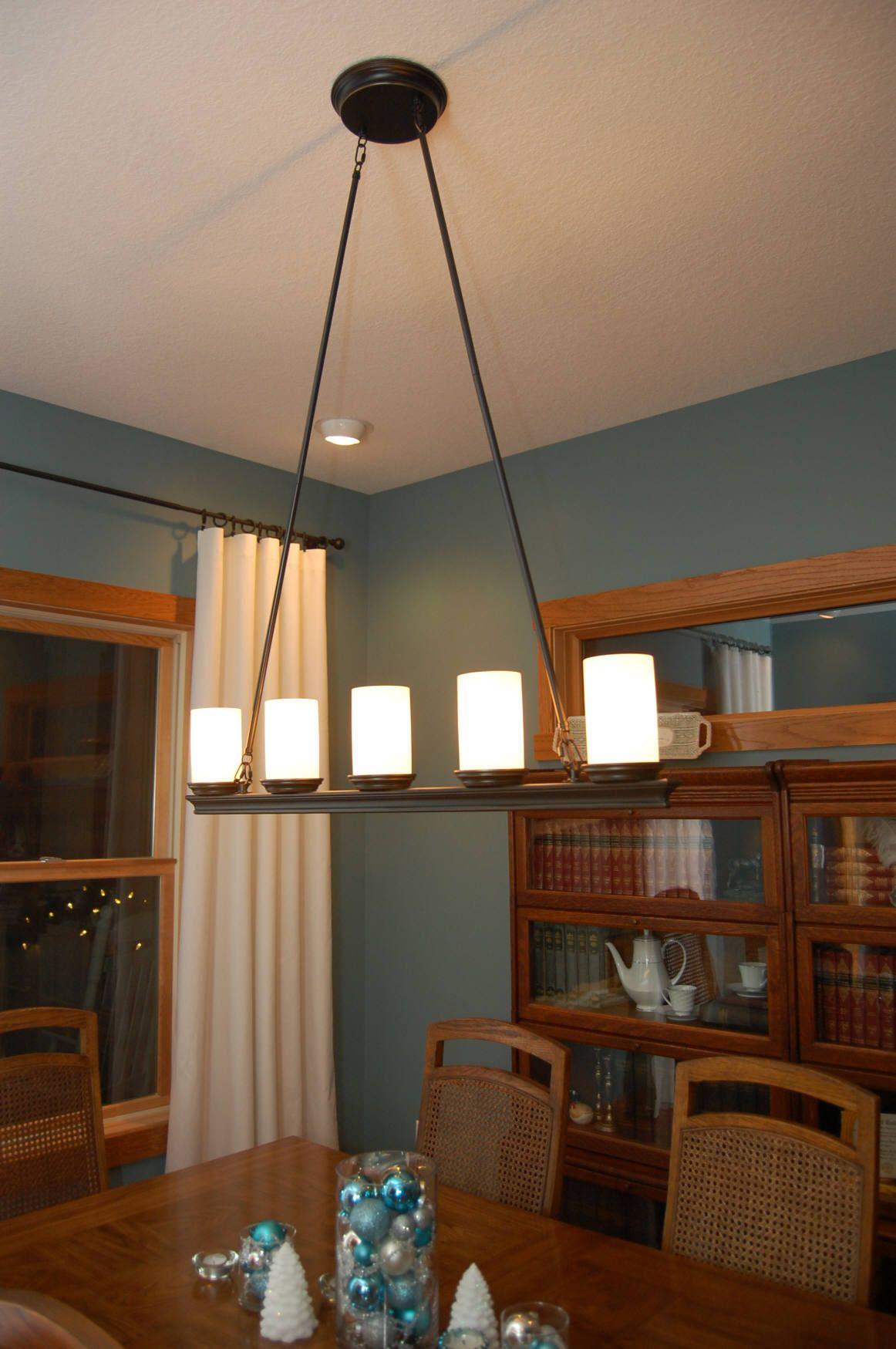 Impressive Line Candle Chandelier As Dining Room Lights Uk Above Light Brown Hardwood Table With Blue Jar Decoration Magnificent