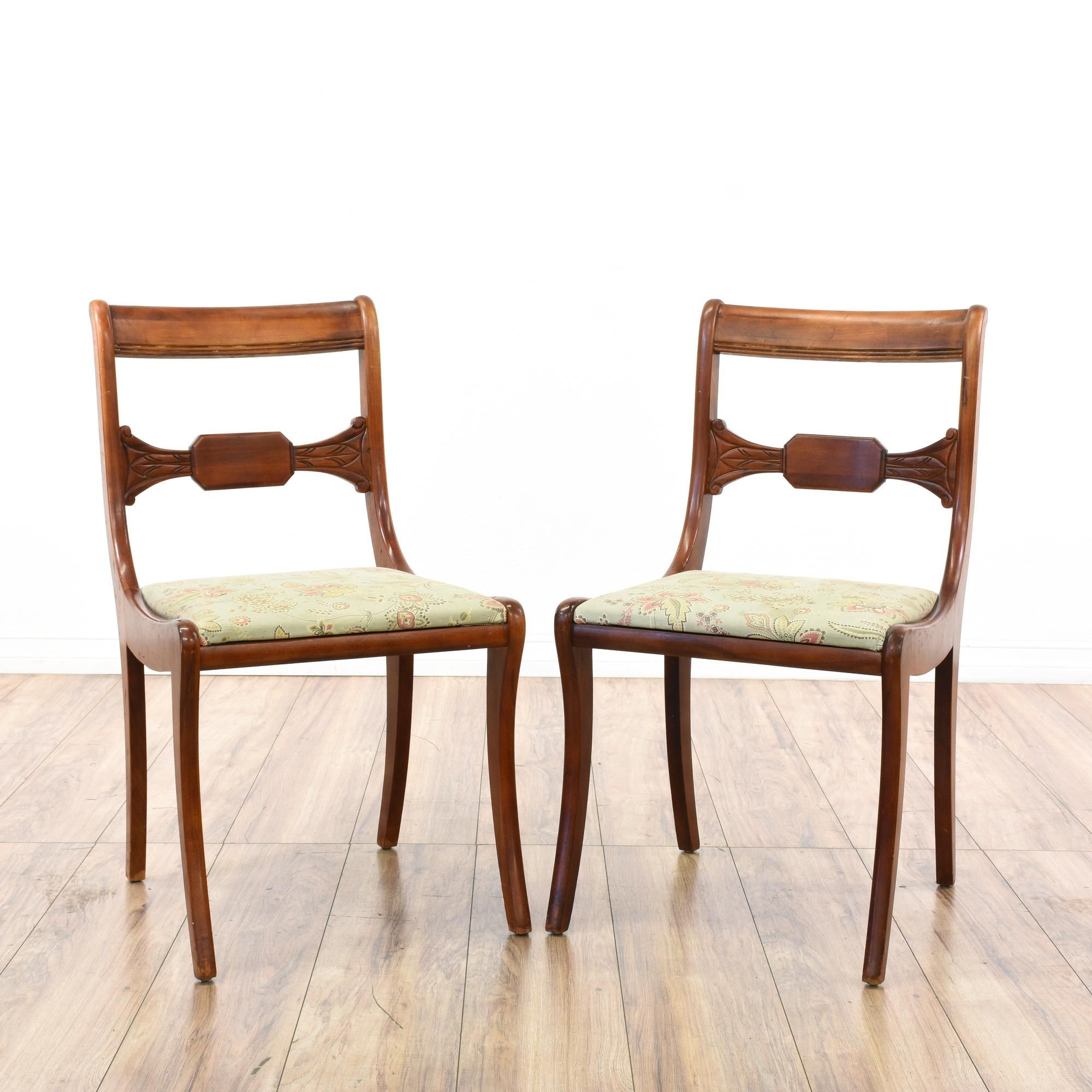 This pair of dining chairs is featured in a solid wood with a