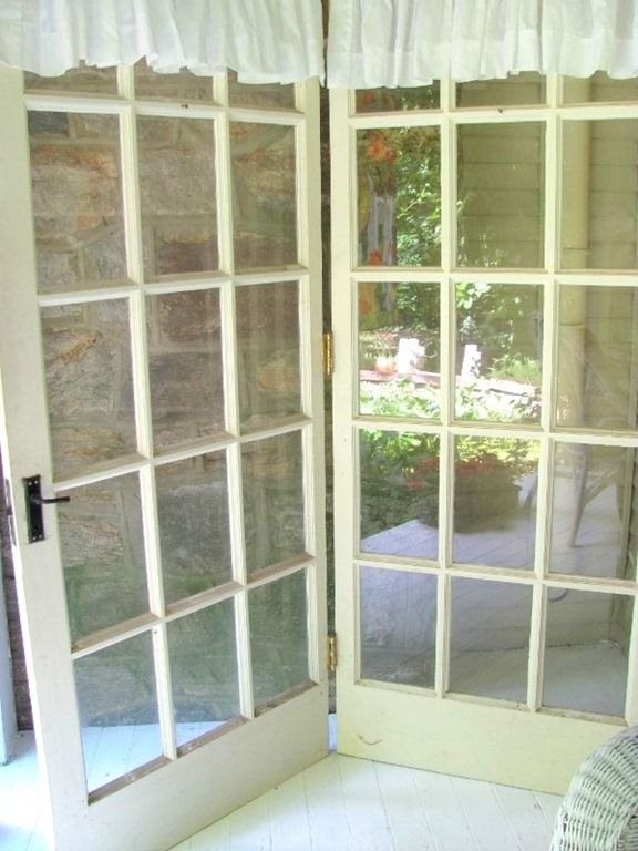 French doors turned into bifold http://www.craftsalamode.com/2013/06/the-little-porch-that-could.html