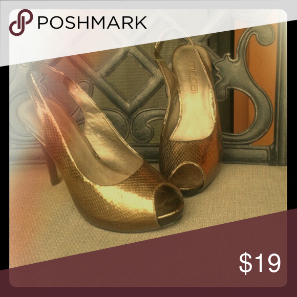 "Moda  sexy metallic heels Size 7.5   Peep toe with  4.5 "" heel. Metallic bronze, hidden platform. Moda Shoes Heels"