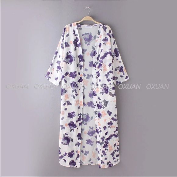 "Beautiful long floral kimono  Super cute long kimono. It is primarily white with purple flowersmade out of cotton and chiffon polyester materialMEASUREMENTS: SMALL--LENGTH: 50""     MEDIUM--LENGTH:50.3""  Tops"