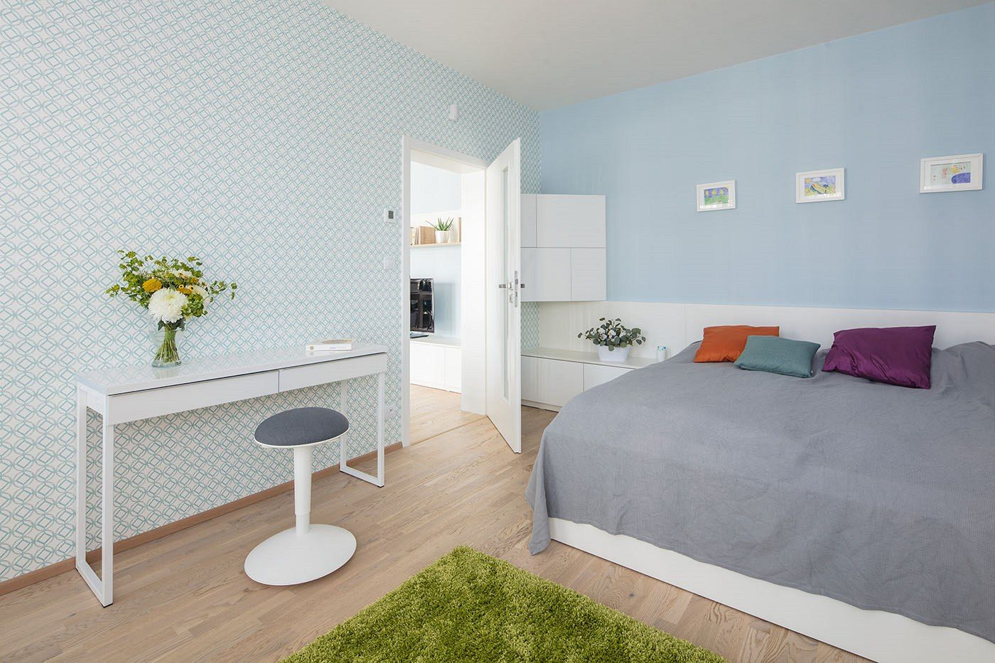Bedroom with sky blue walls and soft colours, fluffy green carpet ...