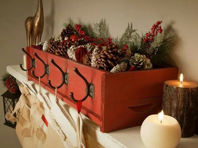 Cute holiday decoration box with stocking holders! ... have cinnamon scented pinecones and candles in red painted box with sandbag for weighting it down... and 2 hooks for hanging our stockings ... then store away when holidays are over - LOVE!
