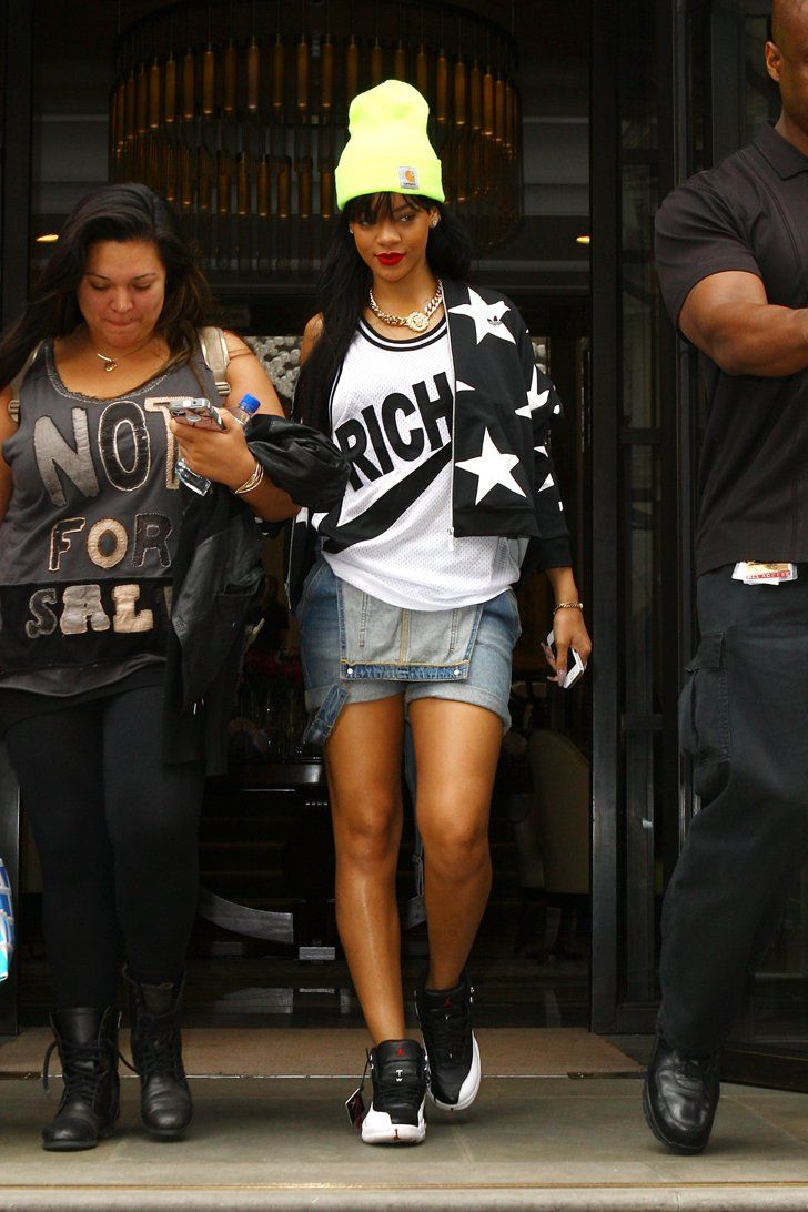 Pin for Later: A Tribute to Rihanna's Killer Street Style on Her 28th Birthday While departing London's Corinthia Hotel, Rihanna married rival sporting brands with an Adidas jacket, a Joyrich jersey, and Nike Air Jordans.