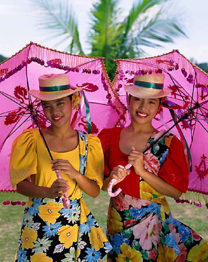 Women Dressed in Traditional Costume (baro at saya or blouse and skirt) in Manila, Philippines