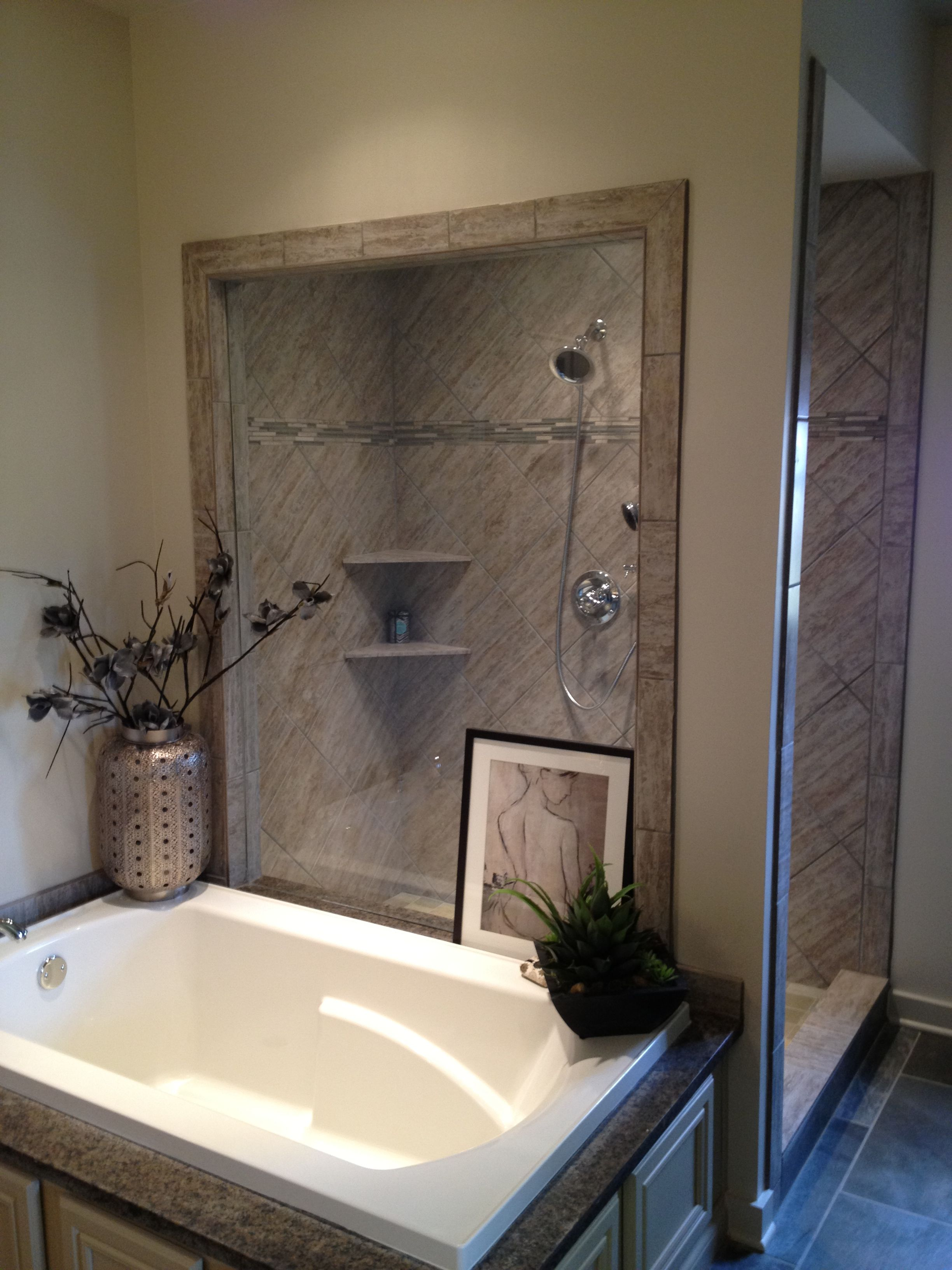 Large soaker tub, framed glass looking into shower, large walk in ...