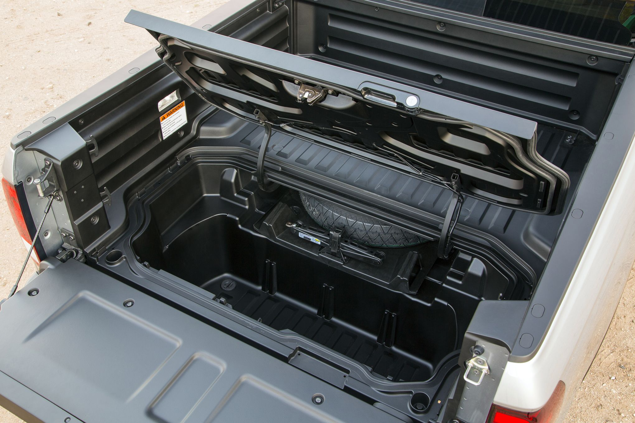 Honda Ridgeline, with inbed cooler and exciters to turn