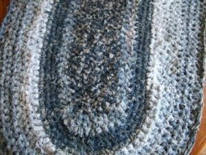 Oval recycled jeans rug. Purses can also be fashioned from crocheted denim strips. myb