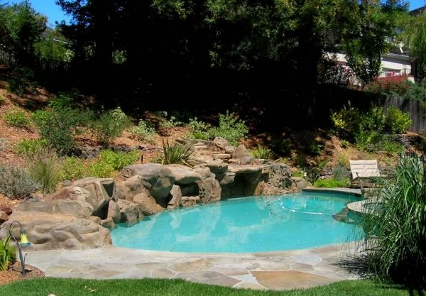 Residential Swimming Pools Category Residential Swimming Pools Image Stonework Blends Into The Hillside Swimming Pool Images Swimming Pool Designs Pool