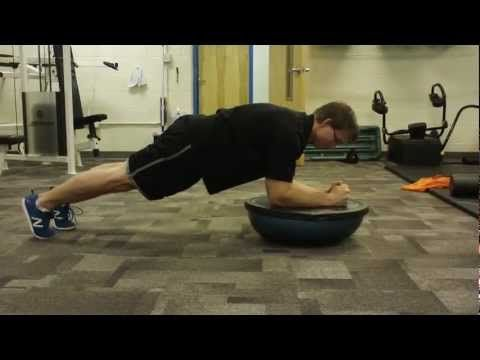 Bosu Plank: this is a great intermediate core training exercise. Try to keep the Bosu flat and use pressure on the forearms. Core tight/ butt tight. www.roypumphrey.com
