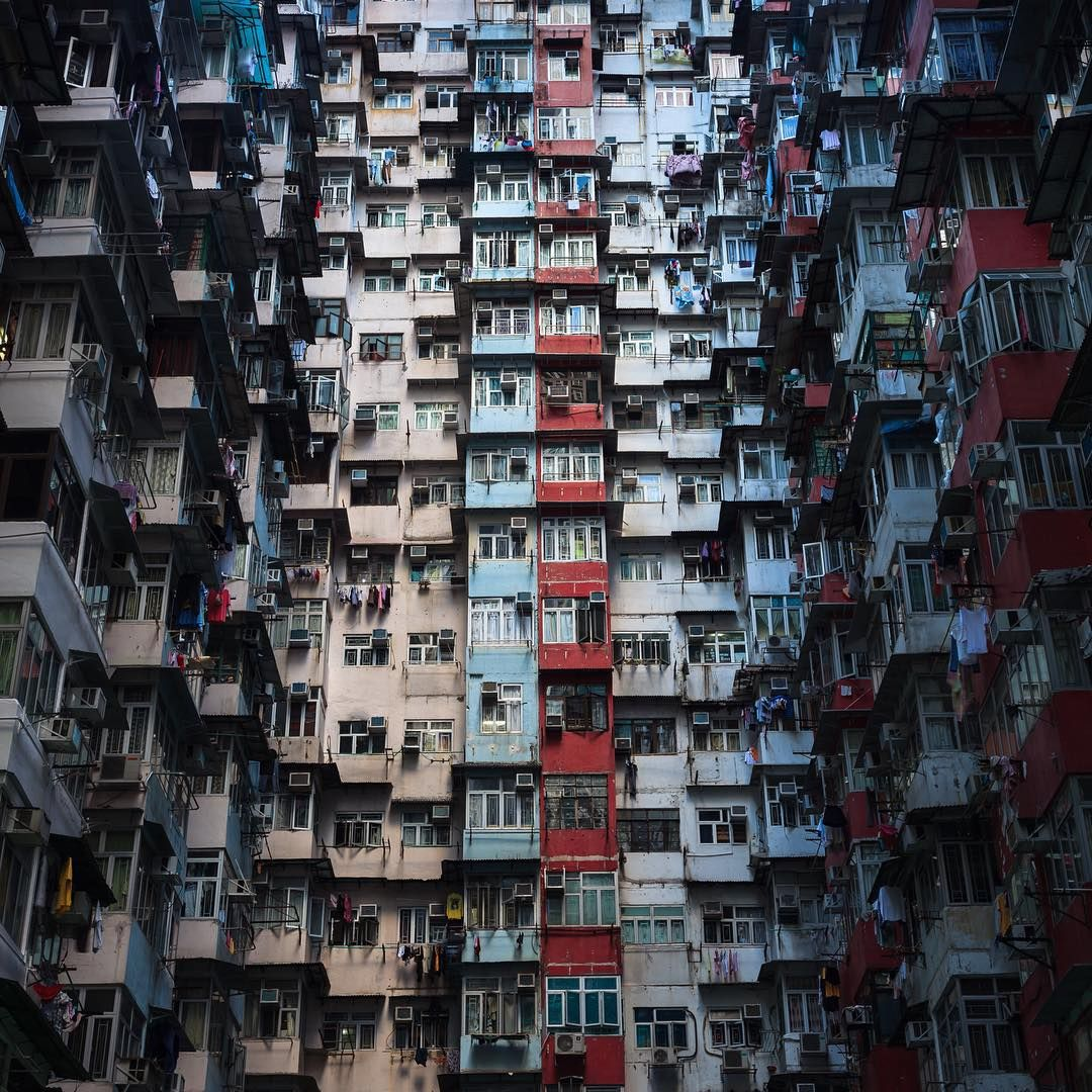 """This estate in Quarry Bay is like entering a natural cave system, with the light exiled and water dripping from hundreds of air-conditioning units. It was both mind-boggling and dazzling imagining how much life — family and individual — surrounded me here, in the center of the concrete jungle."" -@nickseymourphoto Quarry Bay, Hong Kong, China #passionpassport"