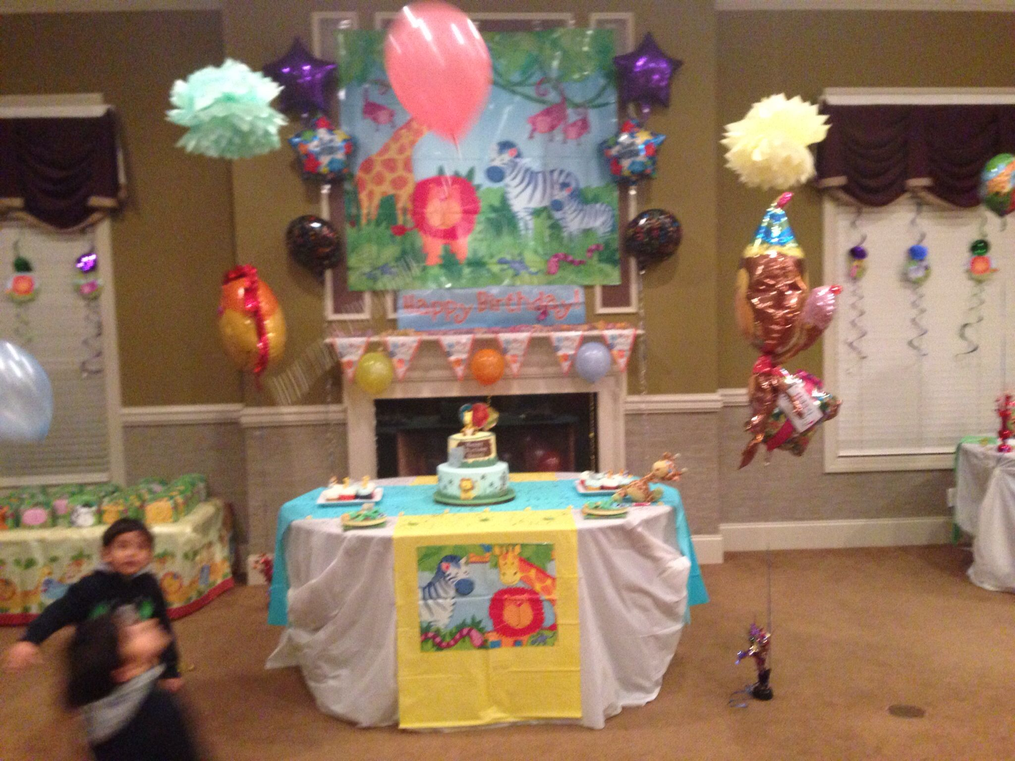Birthday table setup with pompoms on top | Udi\'s Jungle themed first ...