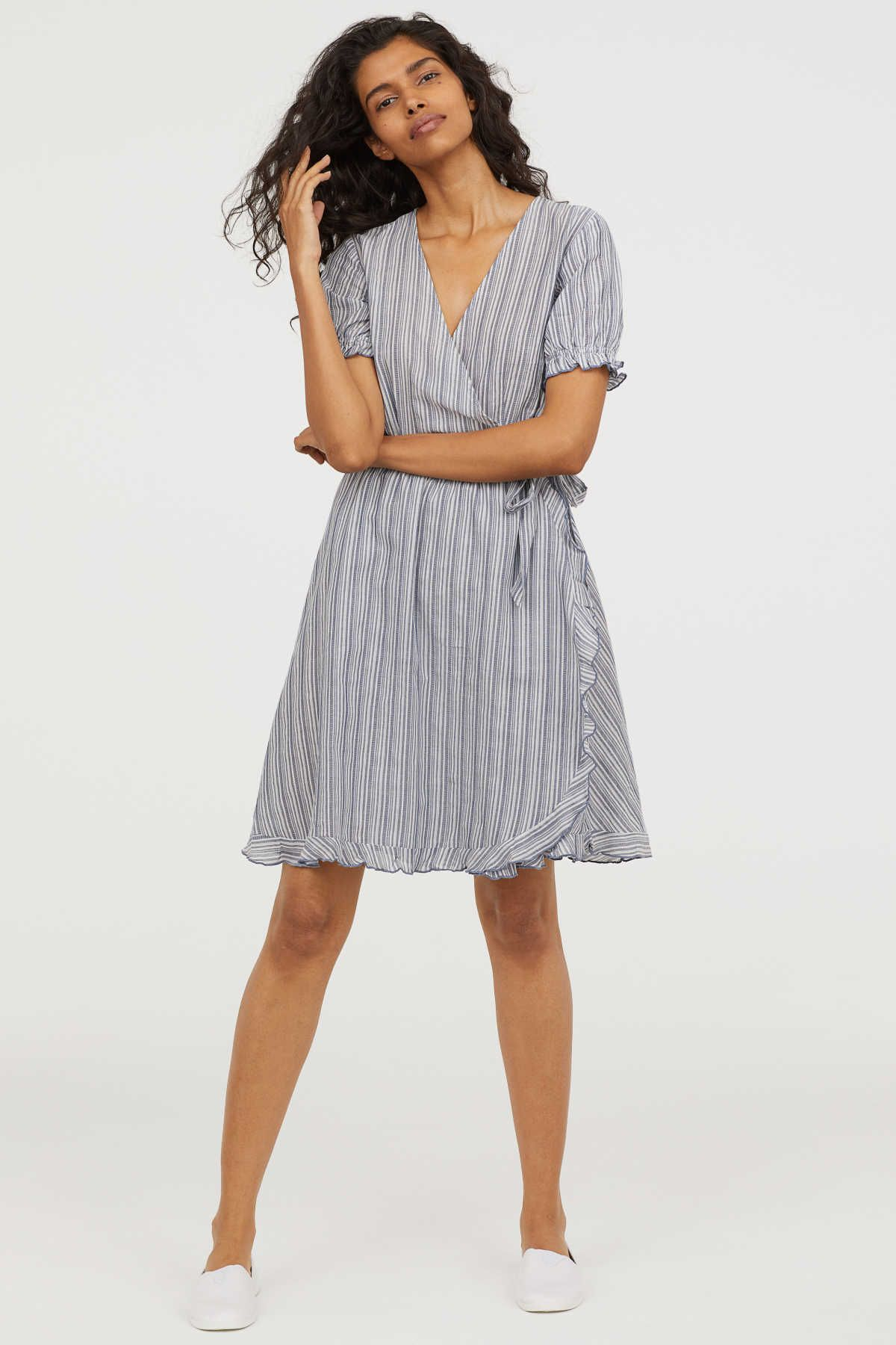01be409476ce Blue/white striped. Knee-length wrap dress in airy, woven cotton fabric.  V-neck, seam at waist with ties, and short puff sleeves with narrow,  elasticized
