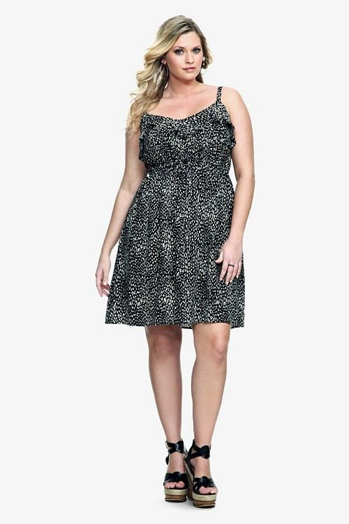 dbe965e7e7b4f A natural animal print brings the wild side out of this black challis dress.  The
