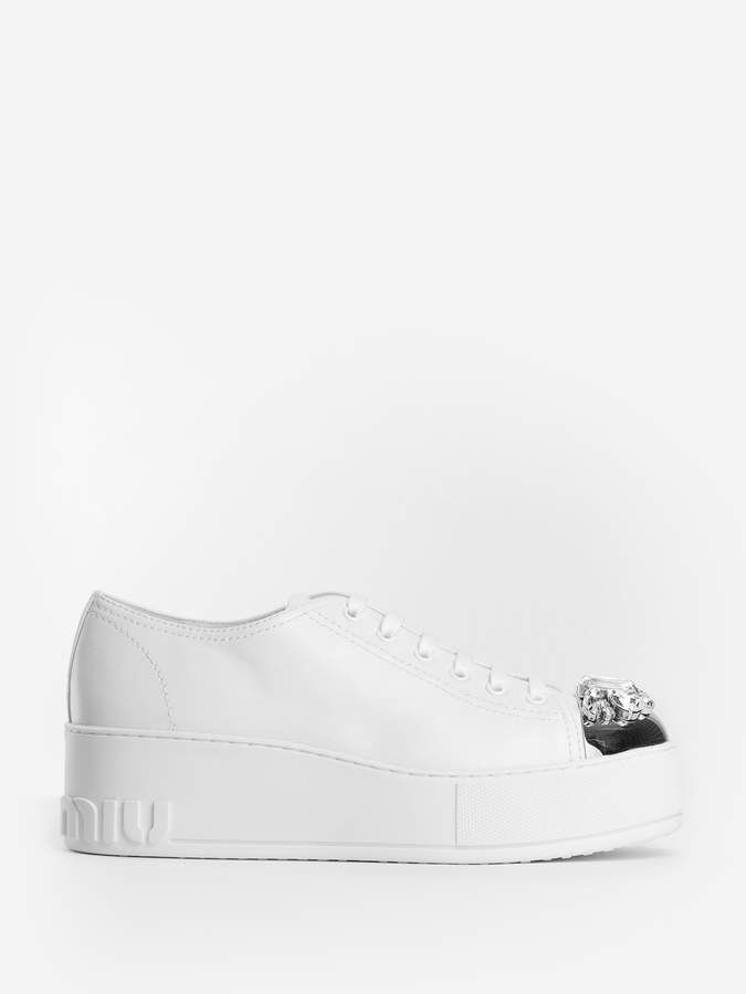 7e31a2592150 MIU MIU  WOMEN S  WHITE  PLATFORM  SNEAKERS! WHITE PLATFORM LACES SILVER  TOE WITH SWAROVSKI INSERTED LOGO EMBOSSED RUBBER SOLE 100% LEATHER MADE IN  ITALY