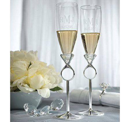 The diamond ring integrated into the stem makes these flutes a unique conversation piece!