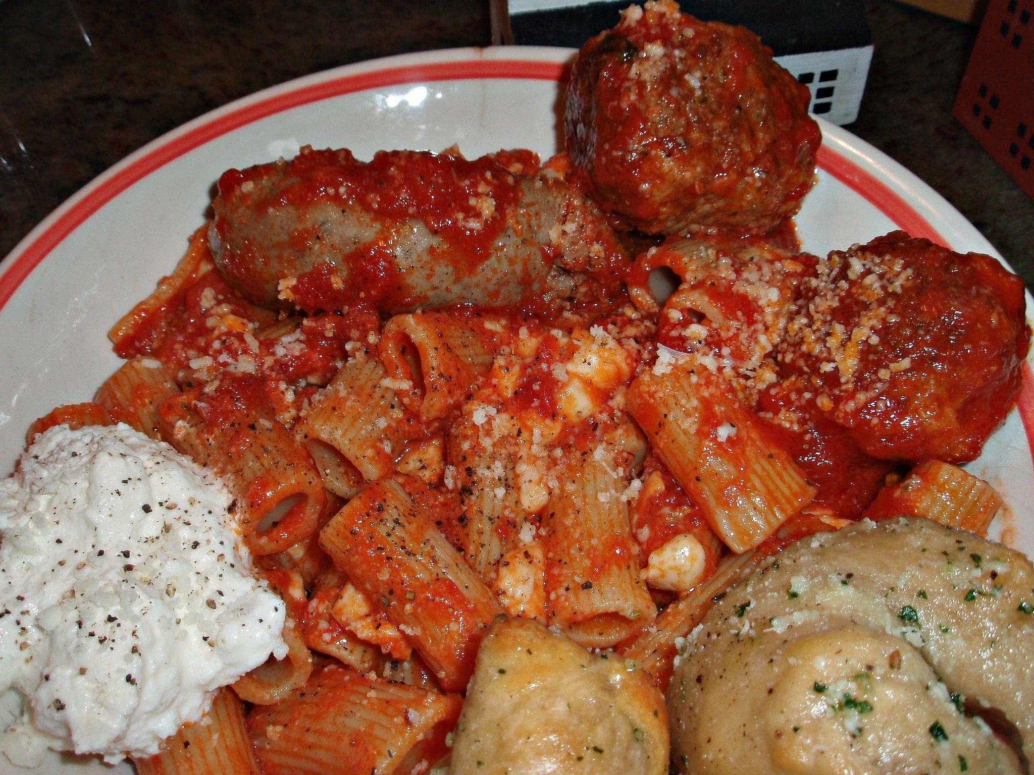 Italian-American Style...Rigatoni with Sunday Sauce, meatballs and sausage,  mozzarella and ricotta..garlic knots.