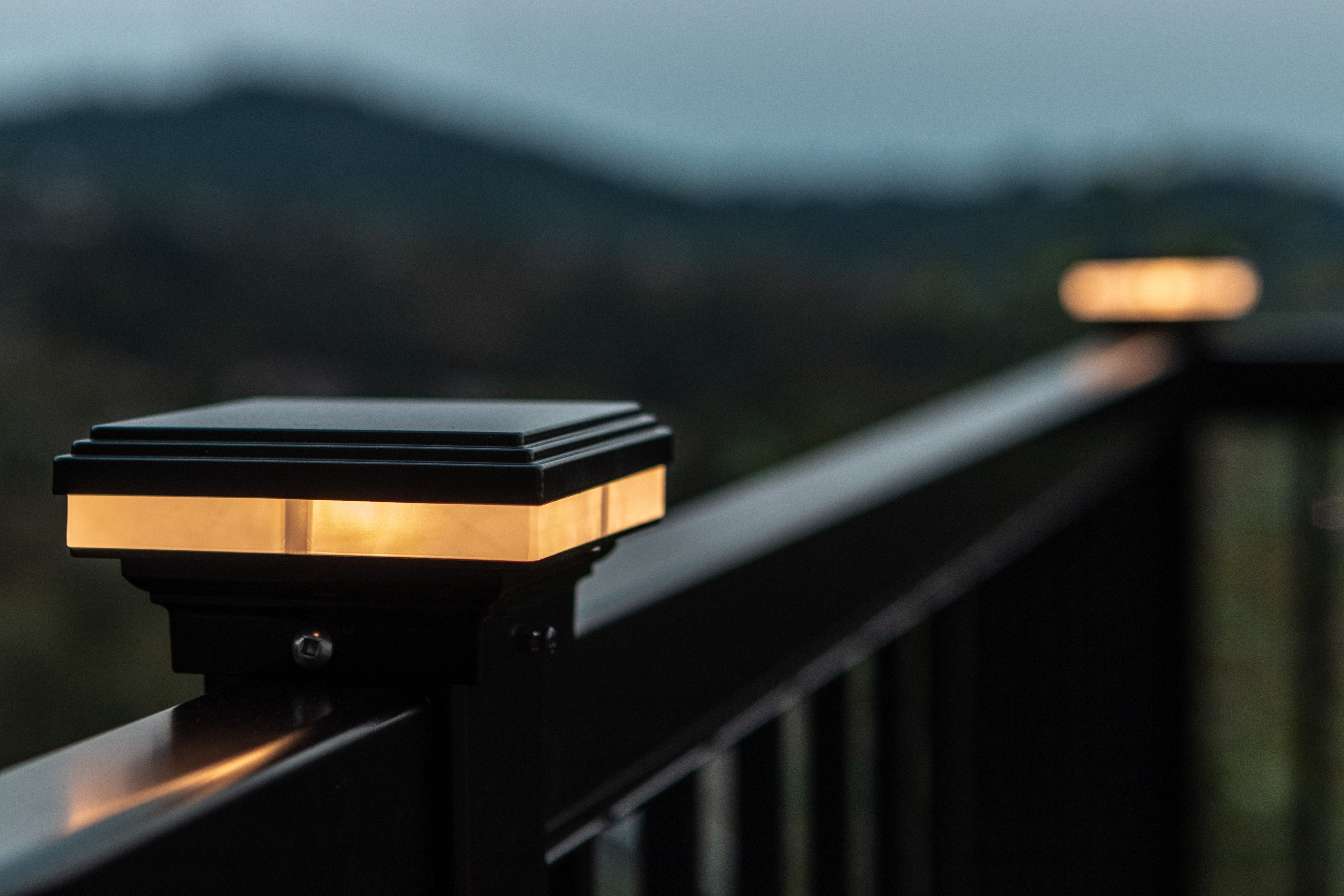 These railing lights add a warm glowy touch to the deck ...