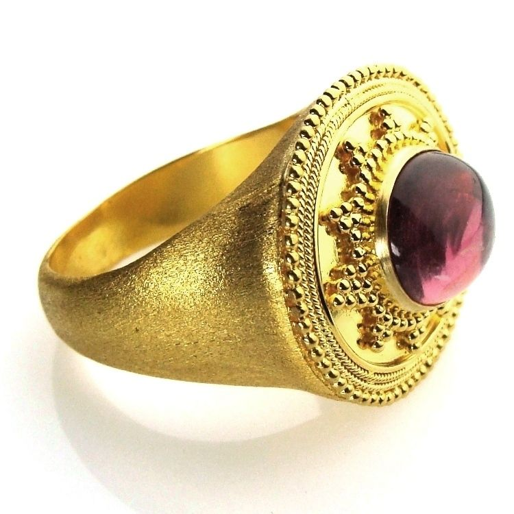 Damaskos Broad Face Tourmaline Ring, 18k Gold and a Tourmaline. http://www.athenas-treasures.com/products/Damaskos-Broad-Face-Tourmaline-Ring.html. This and more handmade Greek jewelry at Athena's Treasures: www.athenas-treasures.com