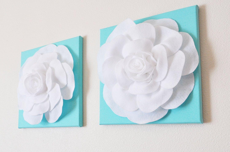 Two wall hangings white roses on aqua blue pool blue x