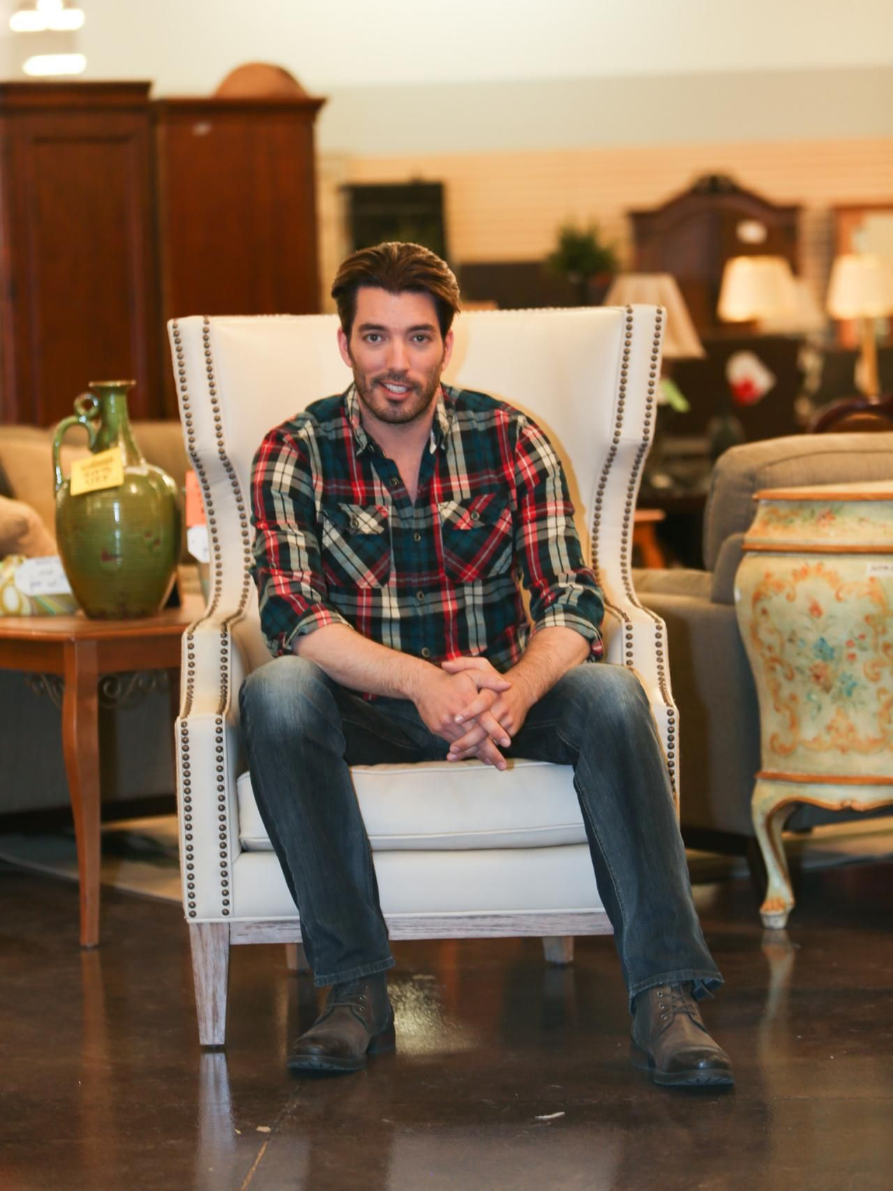 jonathan scott co host of hgtv 39 s property brothers at home takes a seat while shopping at. Black Bedroom Furniture Sets. Home Design Ideas