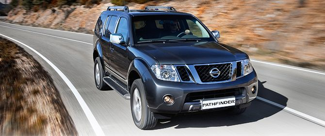 The Pathfinder driving on a country road. | Nissan Pathfinder ...