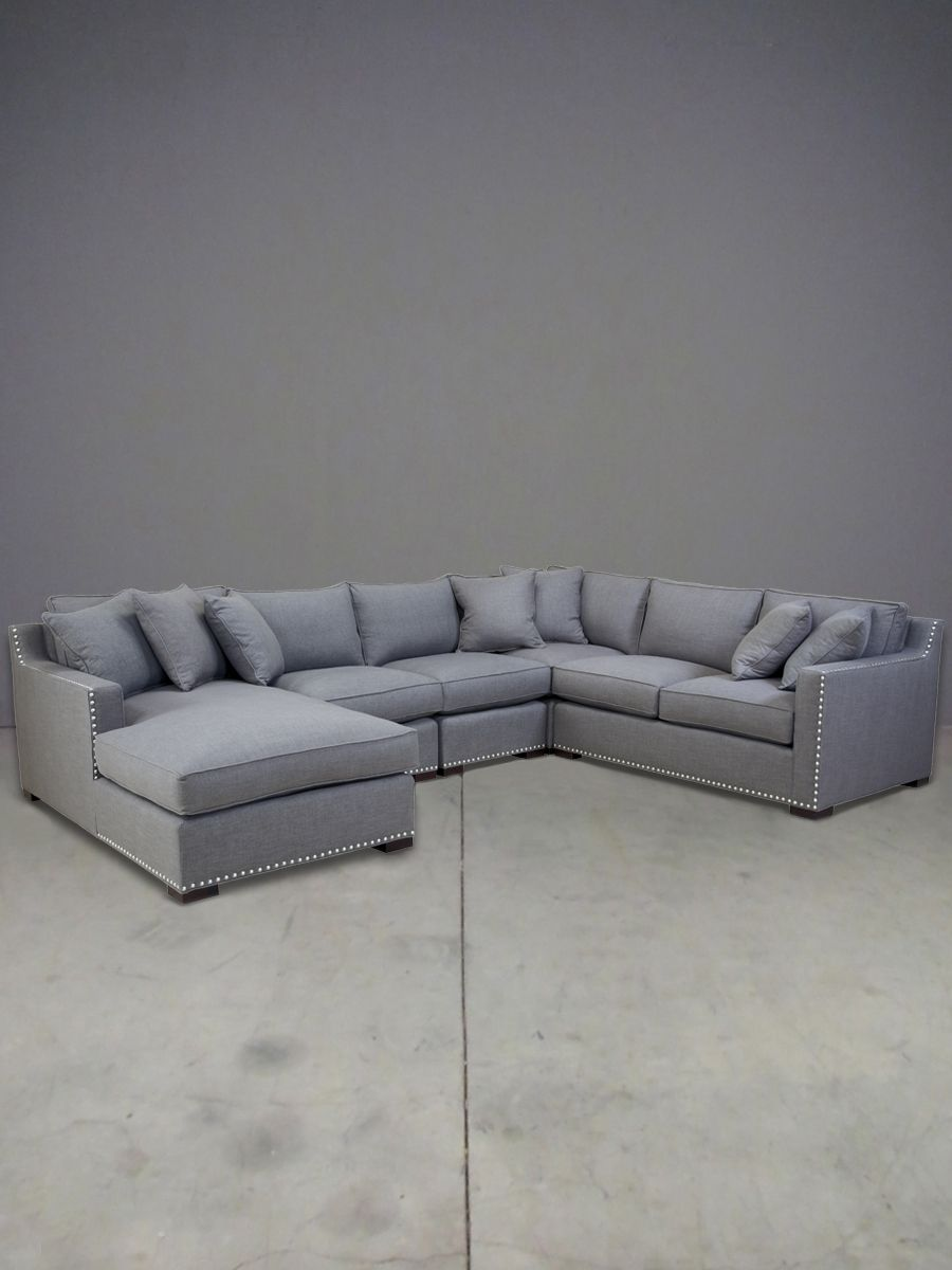 """custom made in the USA, the nixon is a 189 1/2"""" casually luxurious corner sectional, shown in a linen weave fabric with dark stained legs + nailhead detail, but available in a wide range of fabrics, including velvets, patterns + tweeds."""