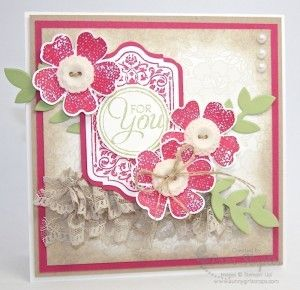 The card base is Whisper White with the card front starting with a layer of Crumb Cake then Rose Red and another layer of Whisper White stamped using the Something Lacy Background Stamp from Stampin' Up! with Sahara Sand Classic Ink.  Chalk Talk, Flower Shop, Pansy punch, vintage buttons, sahara sand lace