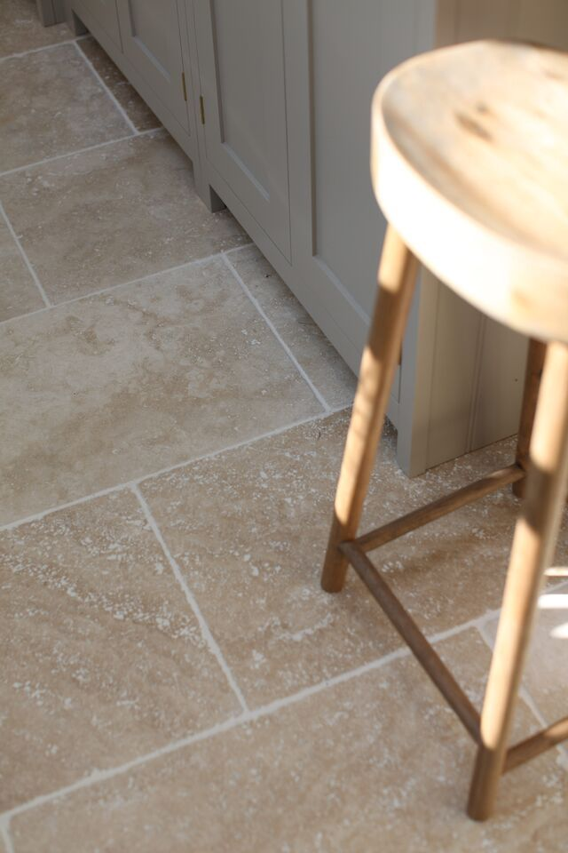 Light Tumbled Travertine In A 610x406 Tile Laid In A Brick Bond