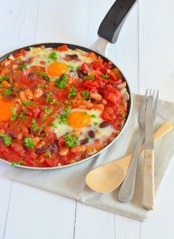 Tasty food hourglass dish is Arabic shakshuka. -